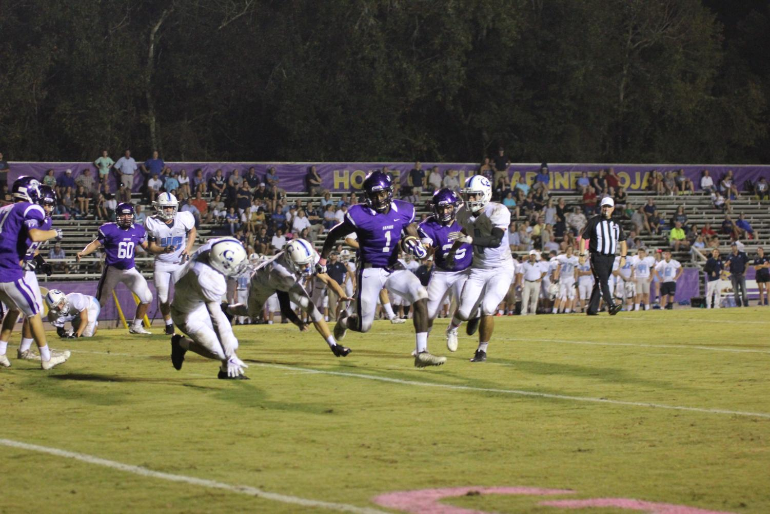 Mike Franklin, #1 Running Back, runs into the endzone to score a touchdown.