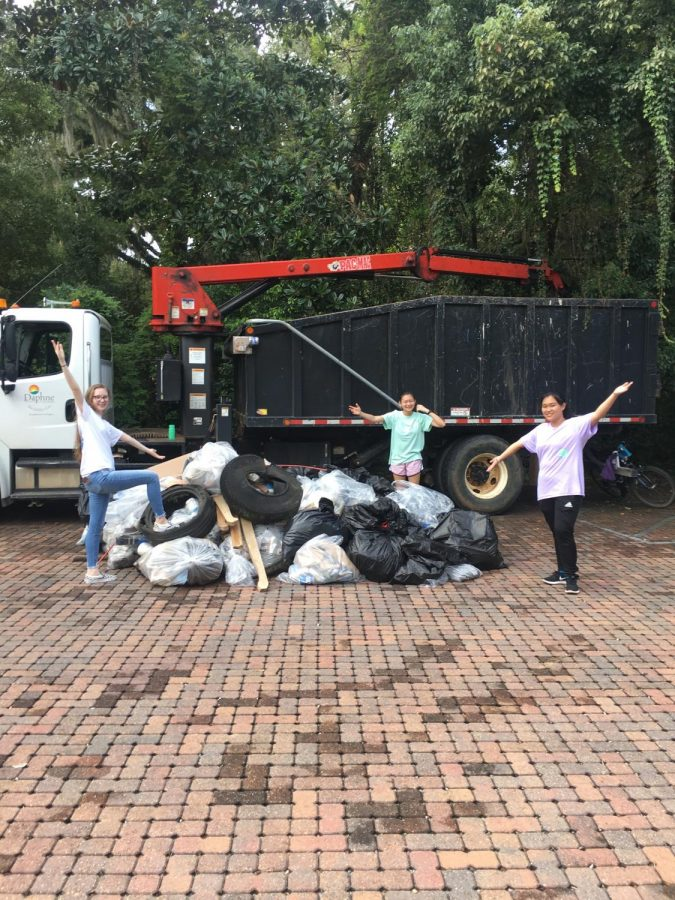 Key Club members standing in front of the trash they collected
