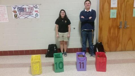Leo Club members stand in the hallway before school asking for donations. Pictured from left to right are Lauren Meyel and Mitchell Weed.