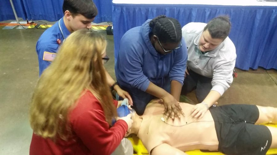 Students learn how to give CPR from trained EMTs.
