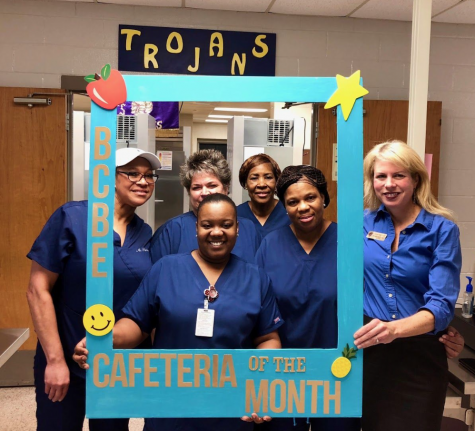 Cafeteria workers and Dr. Foster, Principal celebrate their recognition from the county for a job well done.