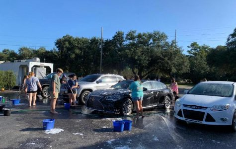 At one point, there were 4 cars being washed
